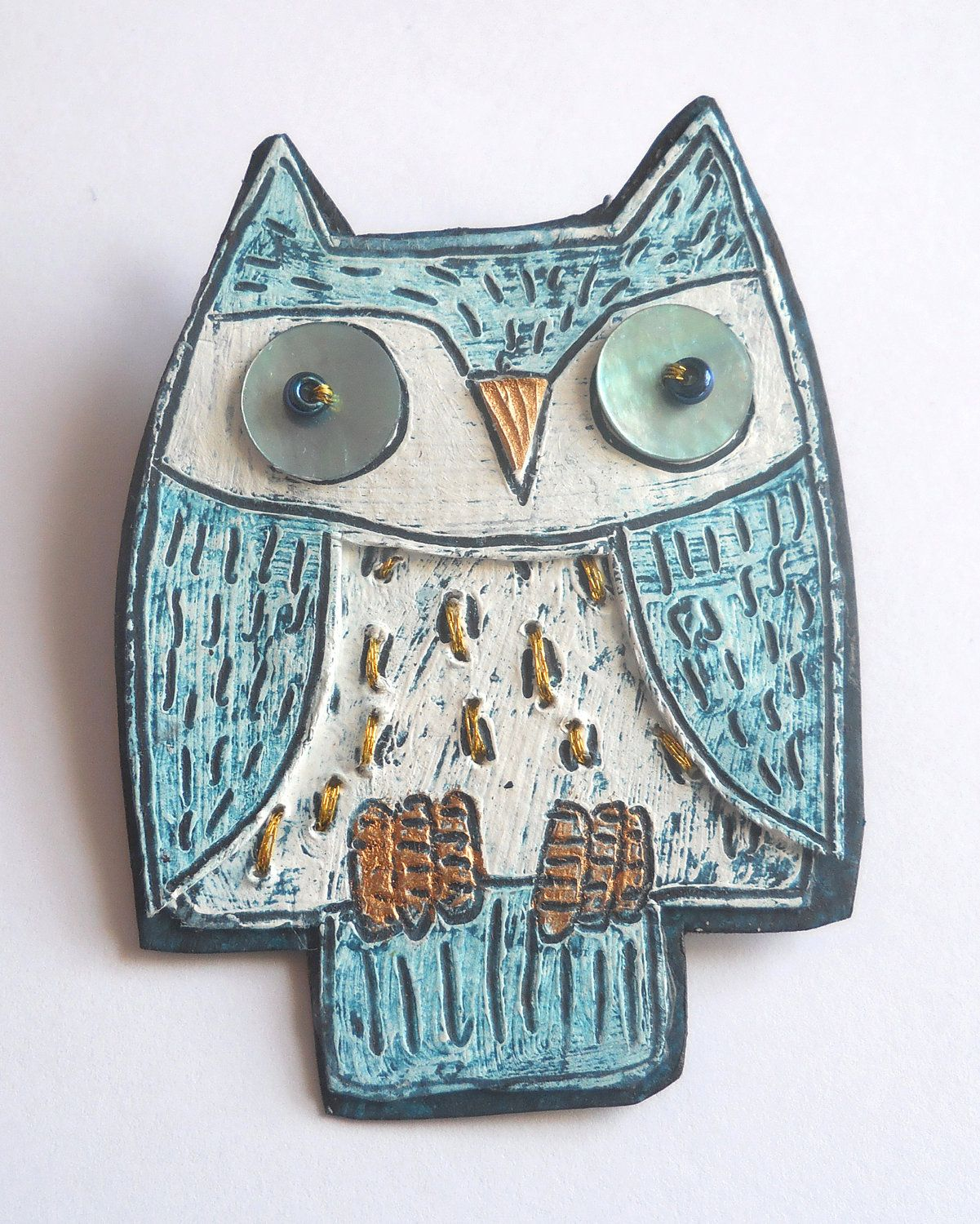 One of my illustrated owl brooches.