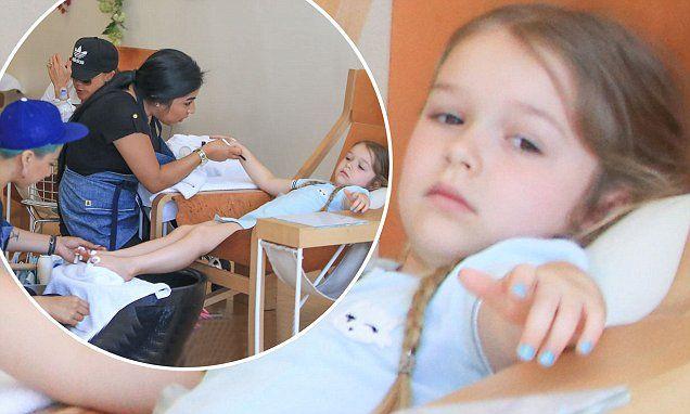 Harper Beckham looks super-cute as she gets a mani-pedi with her mum
