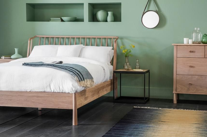 An unusual curve to the spindle headboard gives this bed real ...
