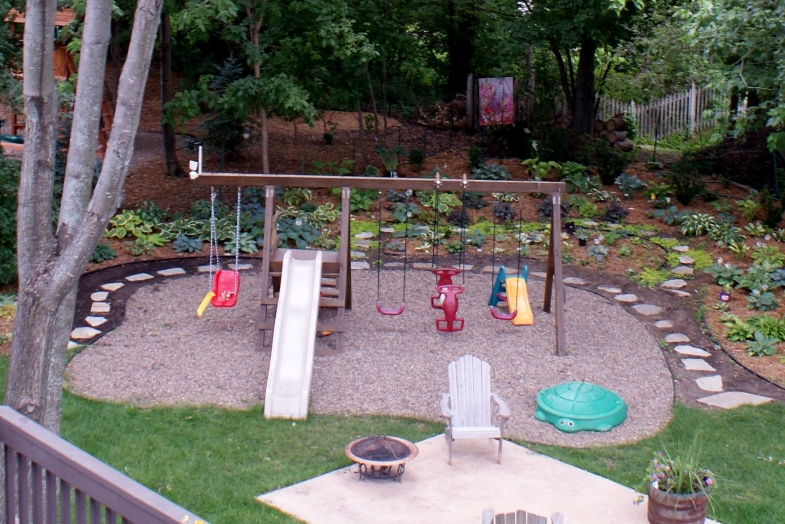 playset with pea gravel create a walkway all the way around
