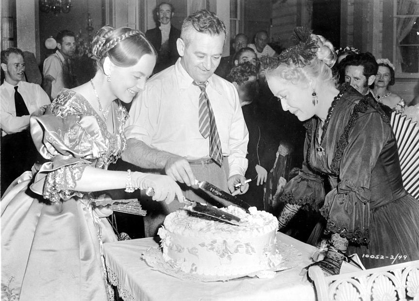 Olivia de Havilland and William Wyler celebrating their birthdays on the set of the Heiress. With Miriam Hopkins