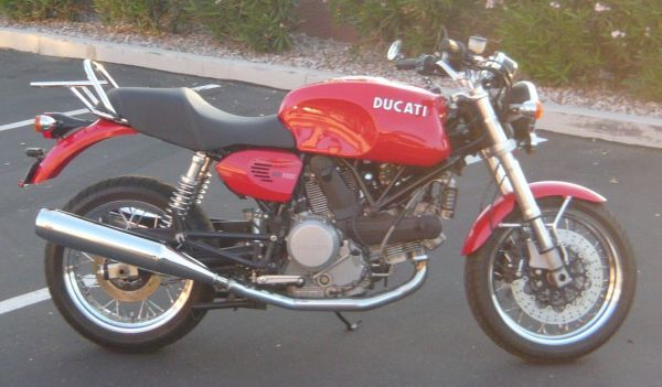 look at her, she's got the boots, with the fur.   Ducati ...