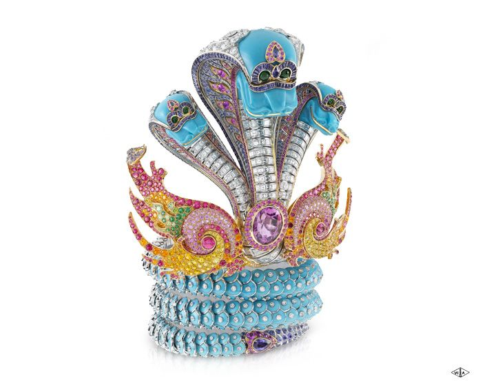 Van Cleef & Arpels - Naga bracelet, Bals de Légende collection - White gold, round diamonds, turquoise, sapphires, garnets, pink opals.    The spectacular Naga bracelet, genuine work of Art from the Bals de Légende™ collection, symbolizes a mythical creature from Cambodian tales and legends.