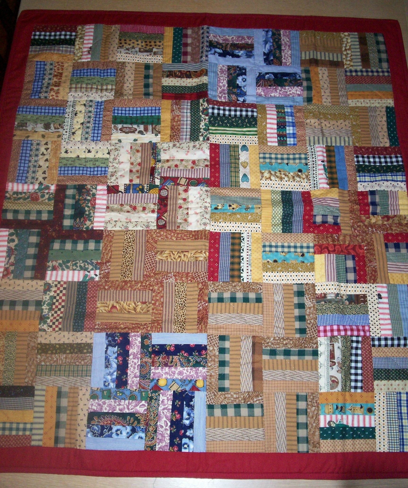 Rail fence quilt made from scrap fabrics.