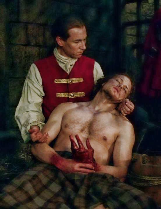 "Season 1, Episode 16, ""To Ransom a Man's Soul,"" Black Jack Randall (Tobias Menzies) and Jamie Fraser (Sam Heughan). screen shot"