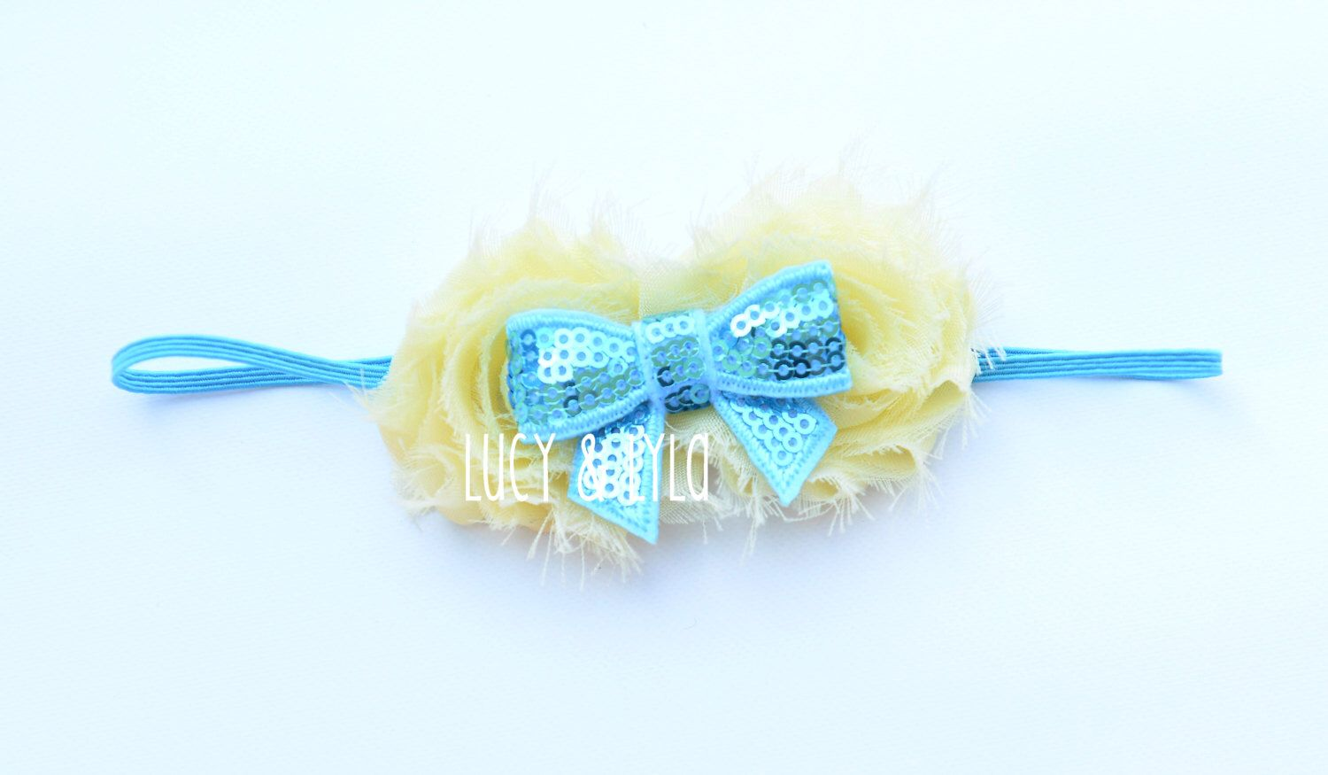 A personal favorite from my Etsy shop https://www.etsy.com/listing/253502398/yellow-and-light-blue-baby-girl-newborn