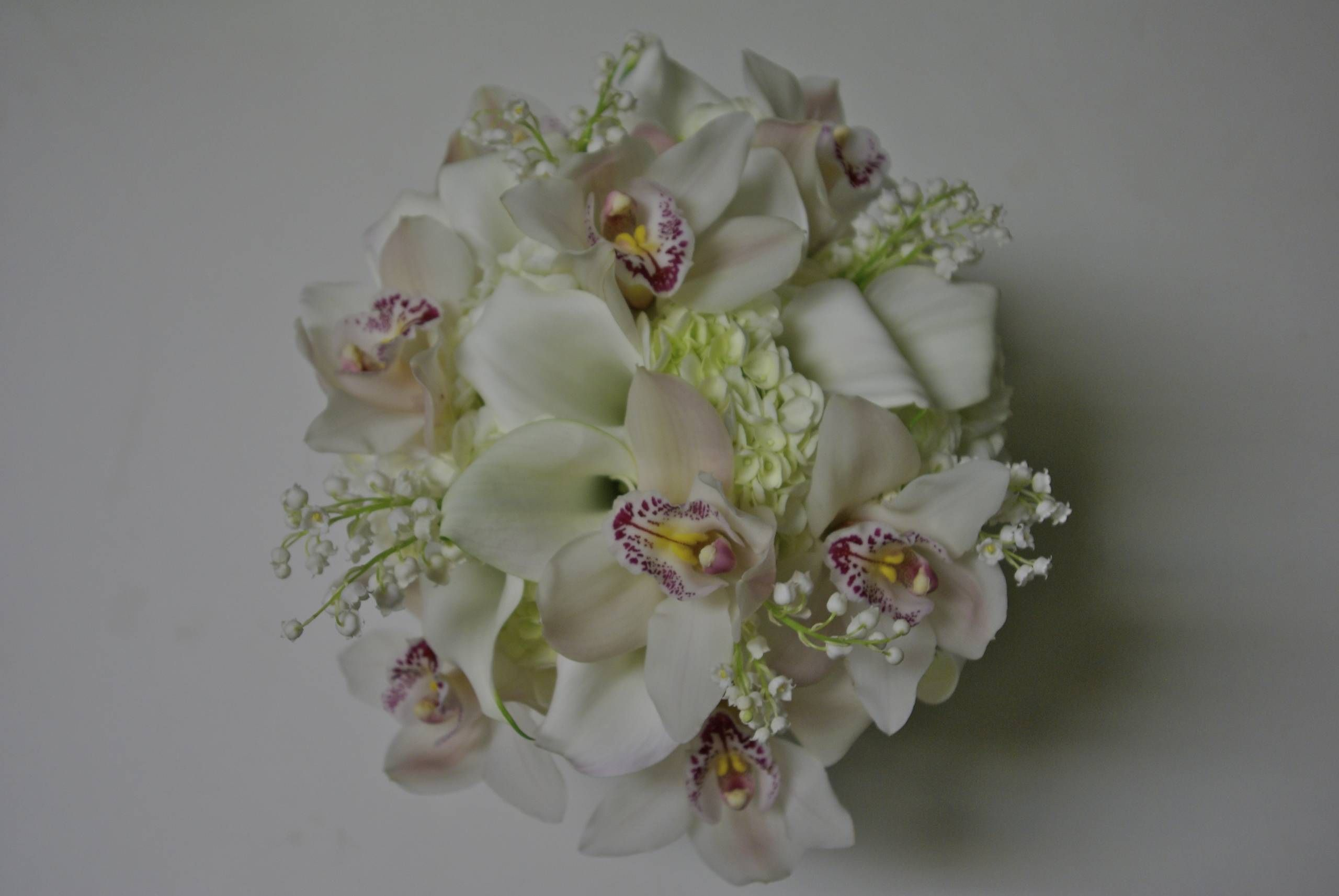 Orchids, Calla Lily, Hydrangea, Lily of the Valley Bridal bouquet #winecountryweddings #sonomaweddings #napaweddings