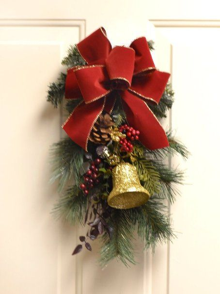 amazoncom christmas door swag with jingle bells and red bow christmas wreaths