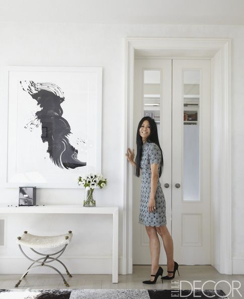 Schifter, who has worked for Vogue and Lucky, in the living room, with a painting by James Nares. - ELLEDecor.com