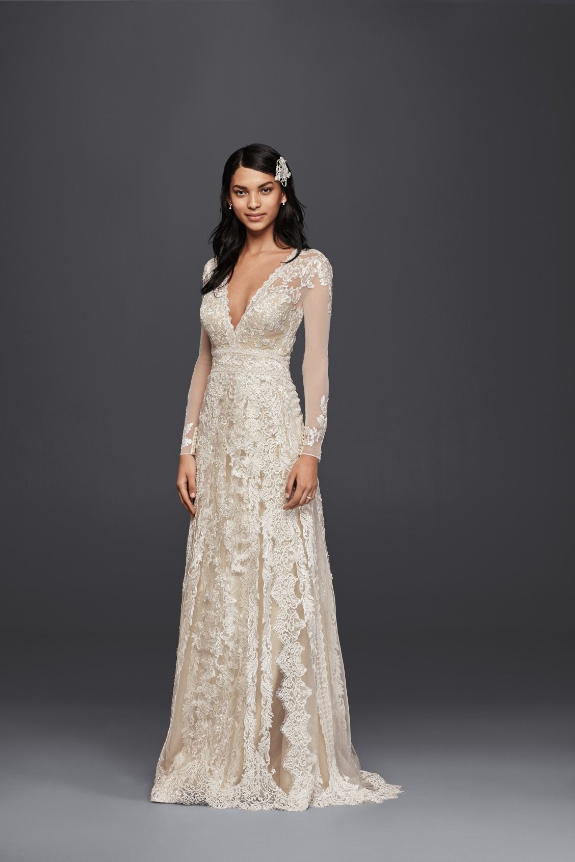 A lace sheath wedding dress with plunging neckline and lace long