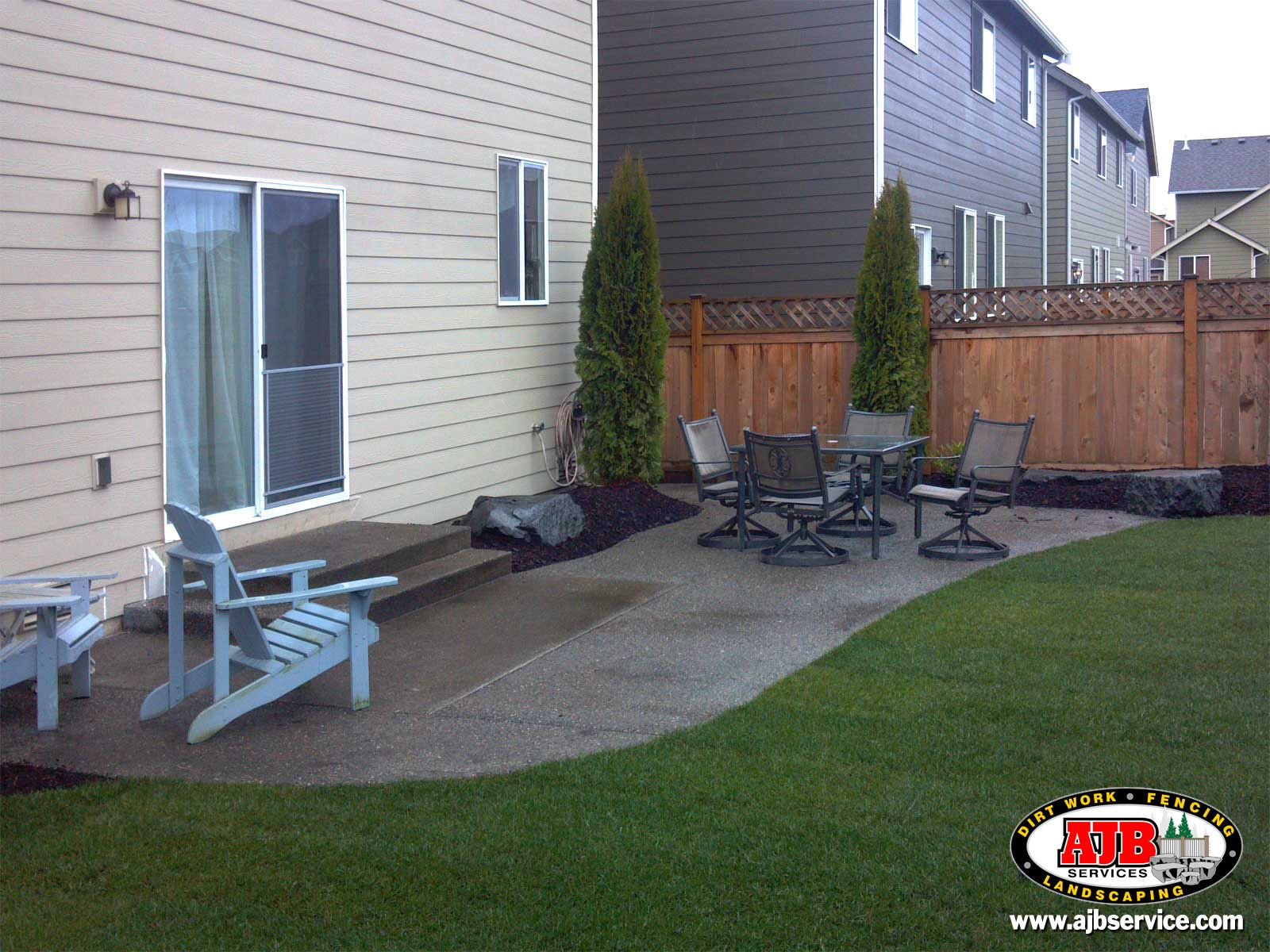 Exposed aggregate concrete patio extension. http//shortn