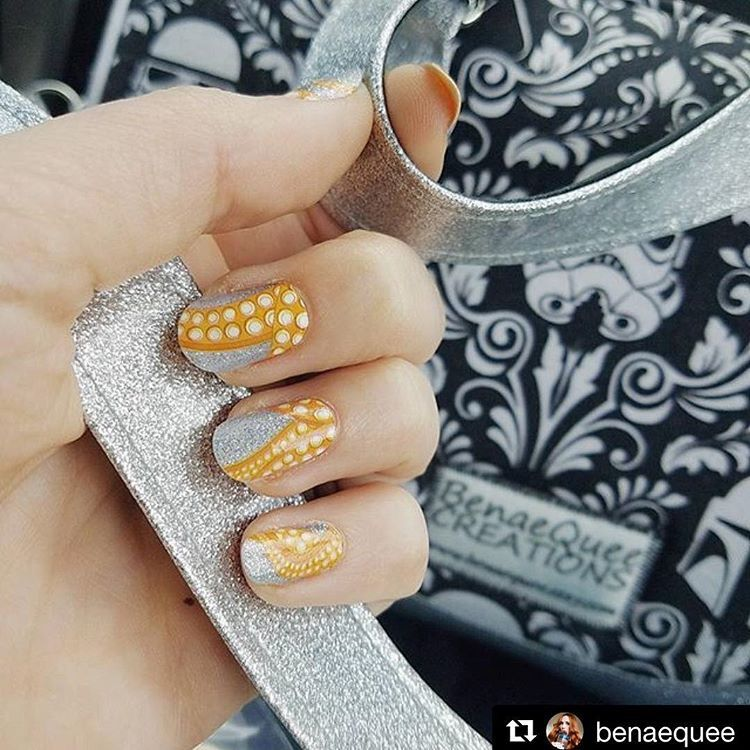 Benaequee on Instagram wearing our Orange & Grey Tentacles nail wraps! We adore this shot! #EspionageCosmetics #NerdManicure #Nails #NailWraps #NailArt #Tentacles #Nailspiration #NOTD