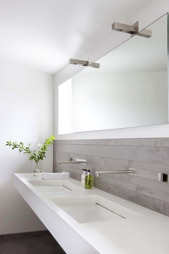 White dual sinks vertical grey tiles bathroom also for the home