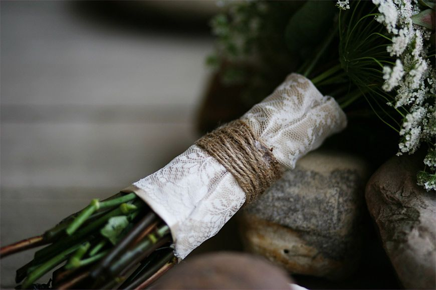 bridal bouquet wrapped in twine over ribbon/lace