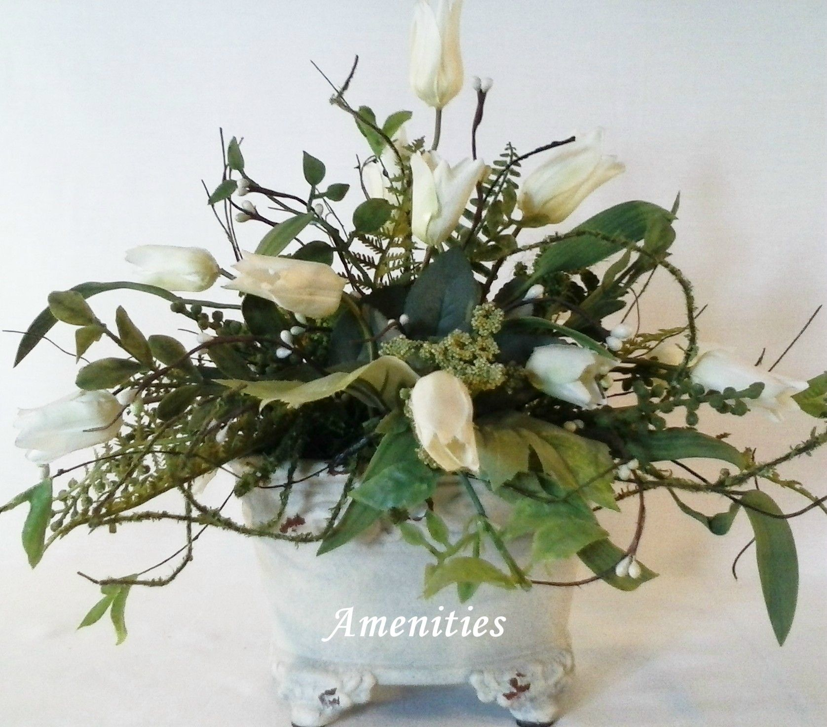 This small white silk flower arrangement of miniature white tulips this small white silk flower arrangement of miniature white tulips makes a great centerpiece for a french country farmhouse feel with its shabby chic mightylinksfo