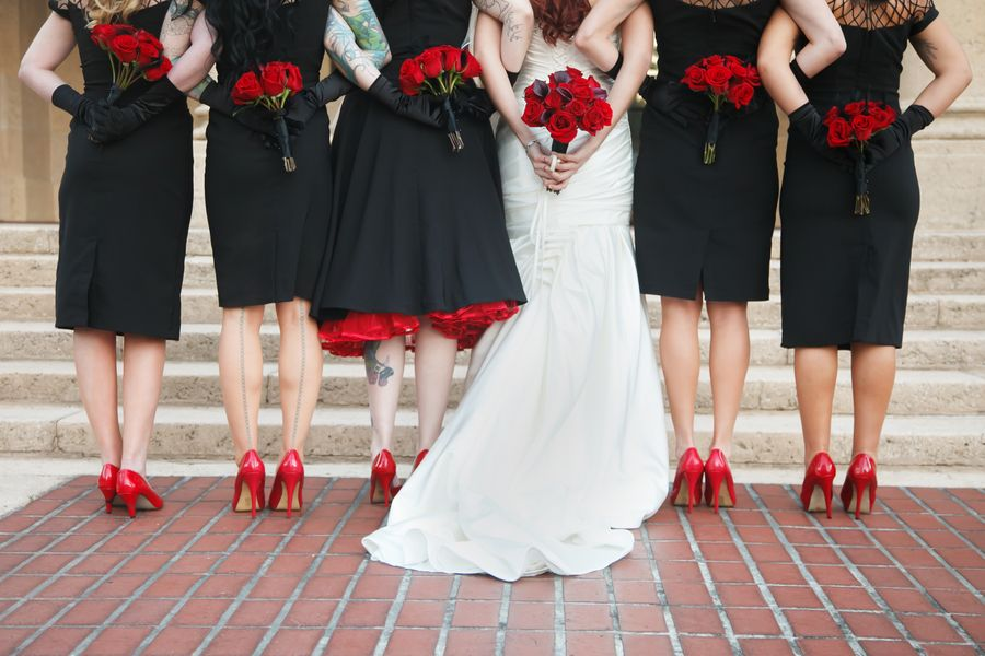 Black bridesmaid dresses with red roses