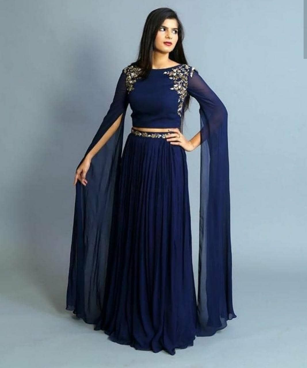 bbb484c72 Crop. Top with bell sleeves full length with hand embroidery and pleated  skirt with belt embroidery. Material - georgette with lining.