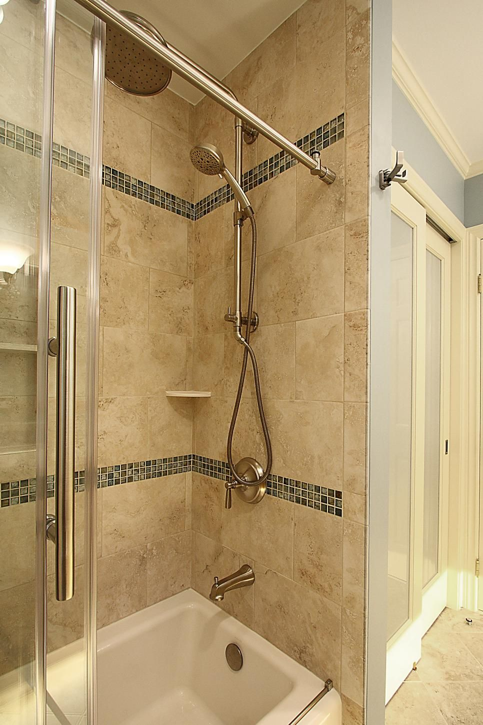 This bathroom remodel included a neutral tile shower paired with a