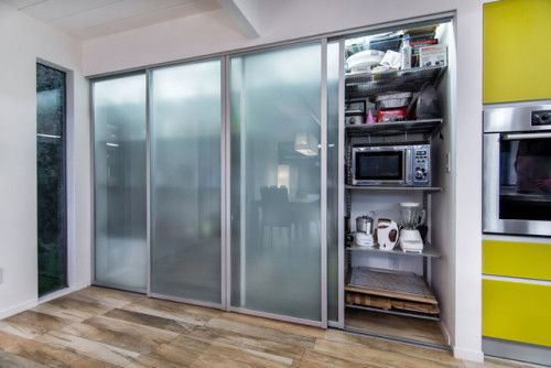 Modern pantry sliding frosted doors for the home for Modern kitchen pantry designs