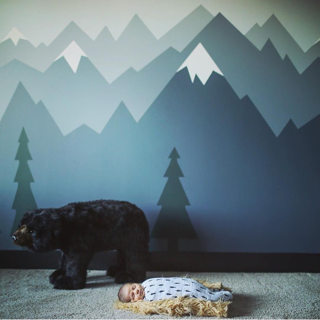Let him sleep for when he wakes he will move for Children room mural