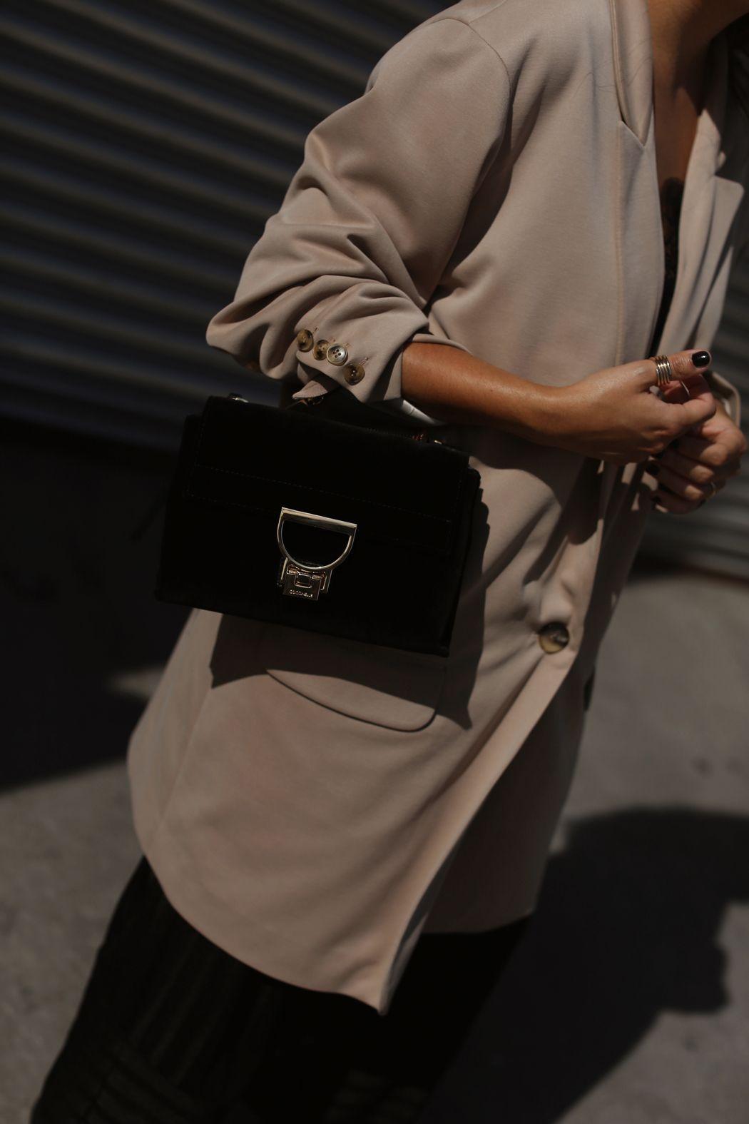 8a0b7114d67 Fiona Dinkelbach from thedashingrider.com wears a camel oversized blazer by HALSTON  HERITAGE, black ZARA culottes, a black velvet COCCINELLE arlettis bag, ...