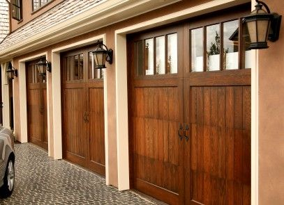 This Three Car Garage Boasts Wood And Glass Stable Style Doors And