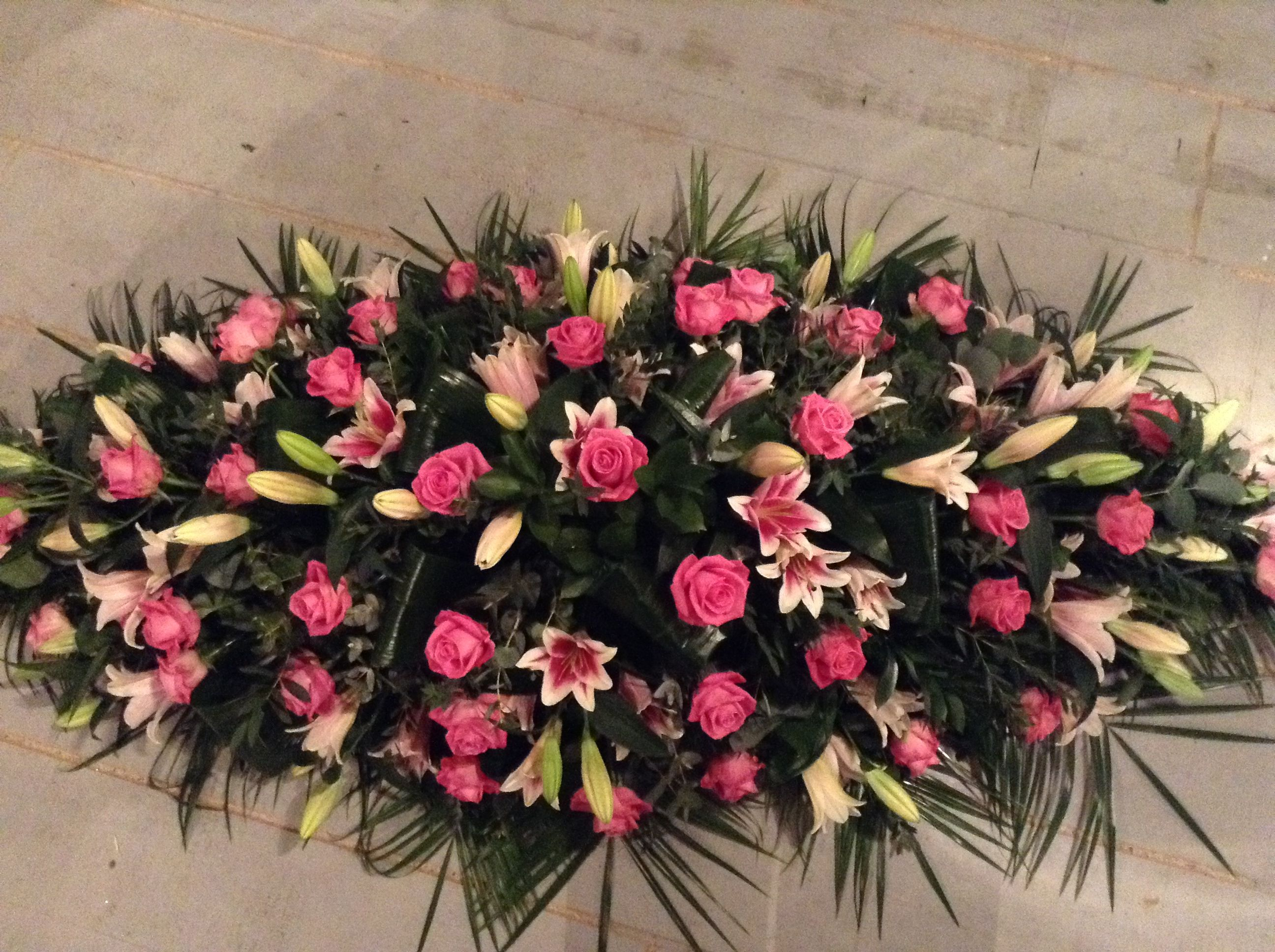 Funeral flowers rose and lily coffin spray pink rose and pink lily funeral flowers rose and lily coffin spray pink rose and pink lily funeral flowers izmirmasajfo