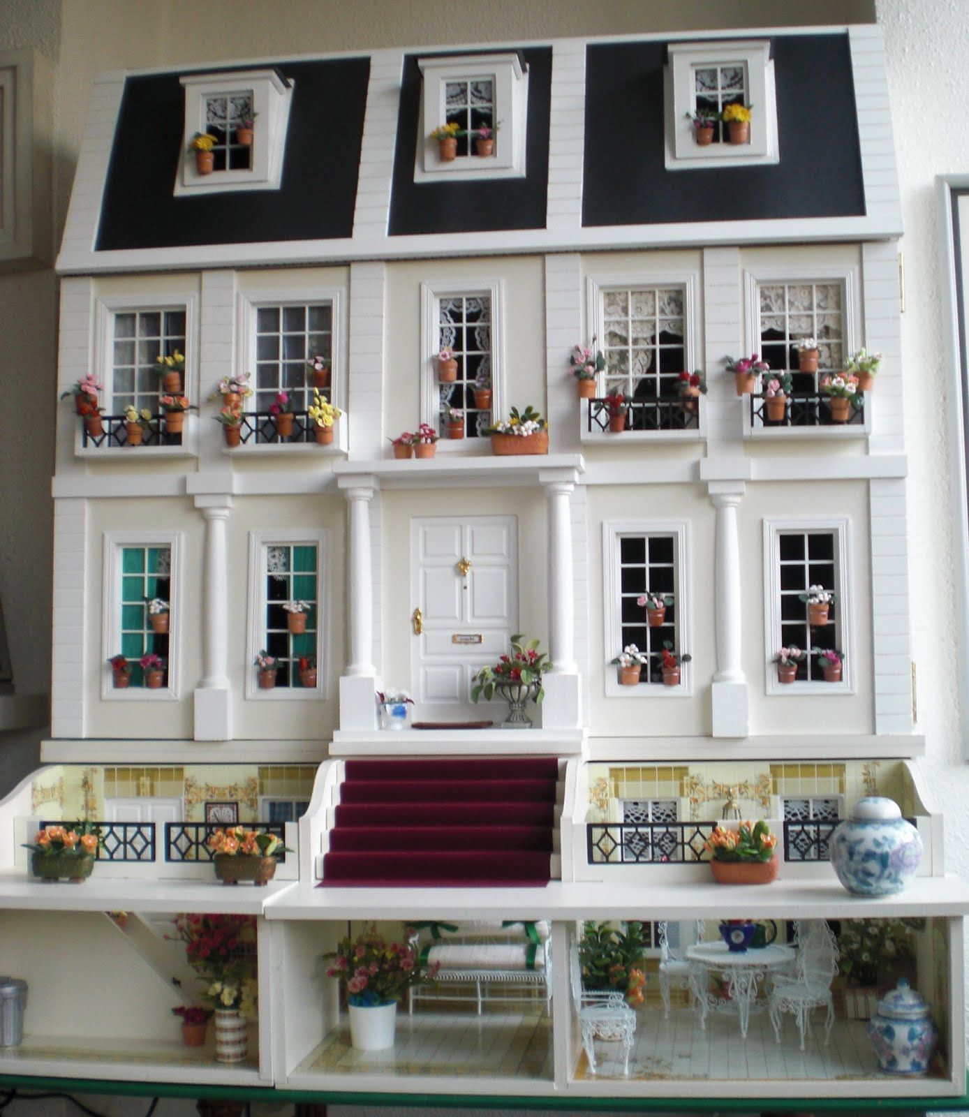 who wrote the dolls house