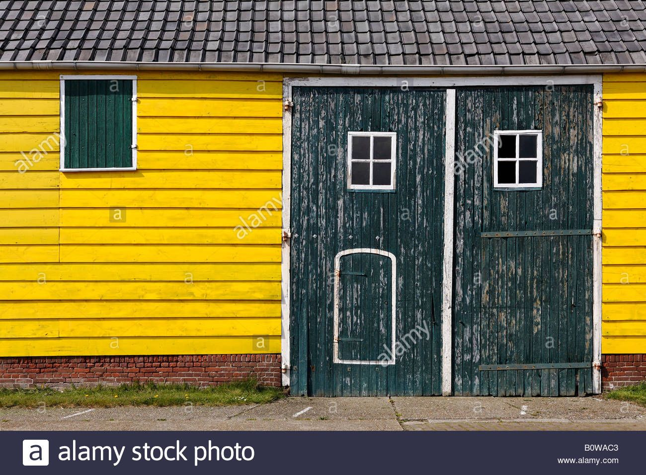 Download this stock image: Bright yellow painted old shed near ...