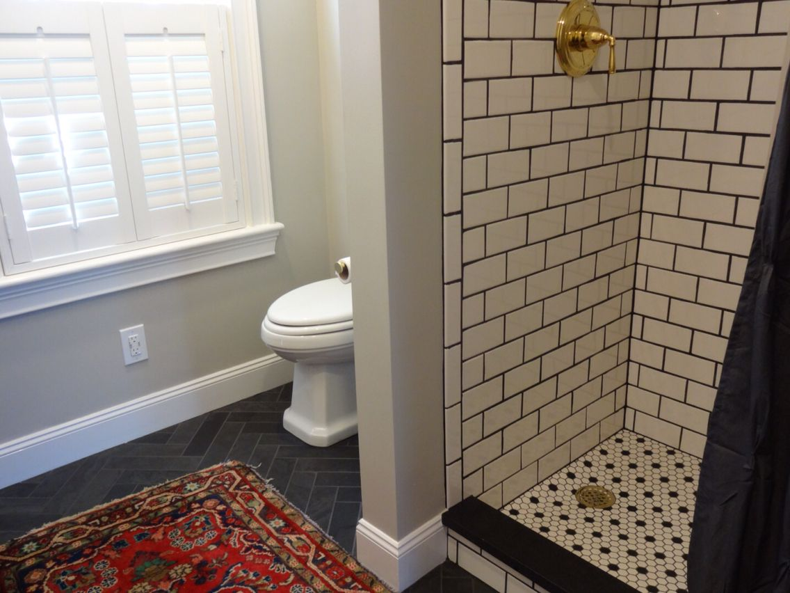 master bath white subway tile with black grout and brass 17416