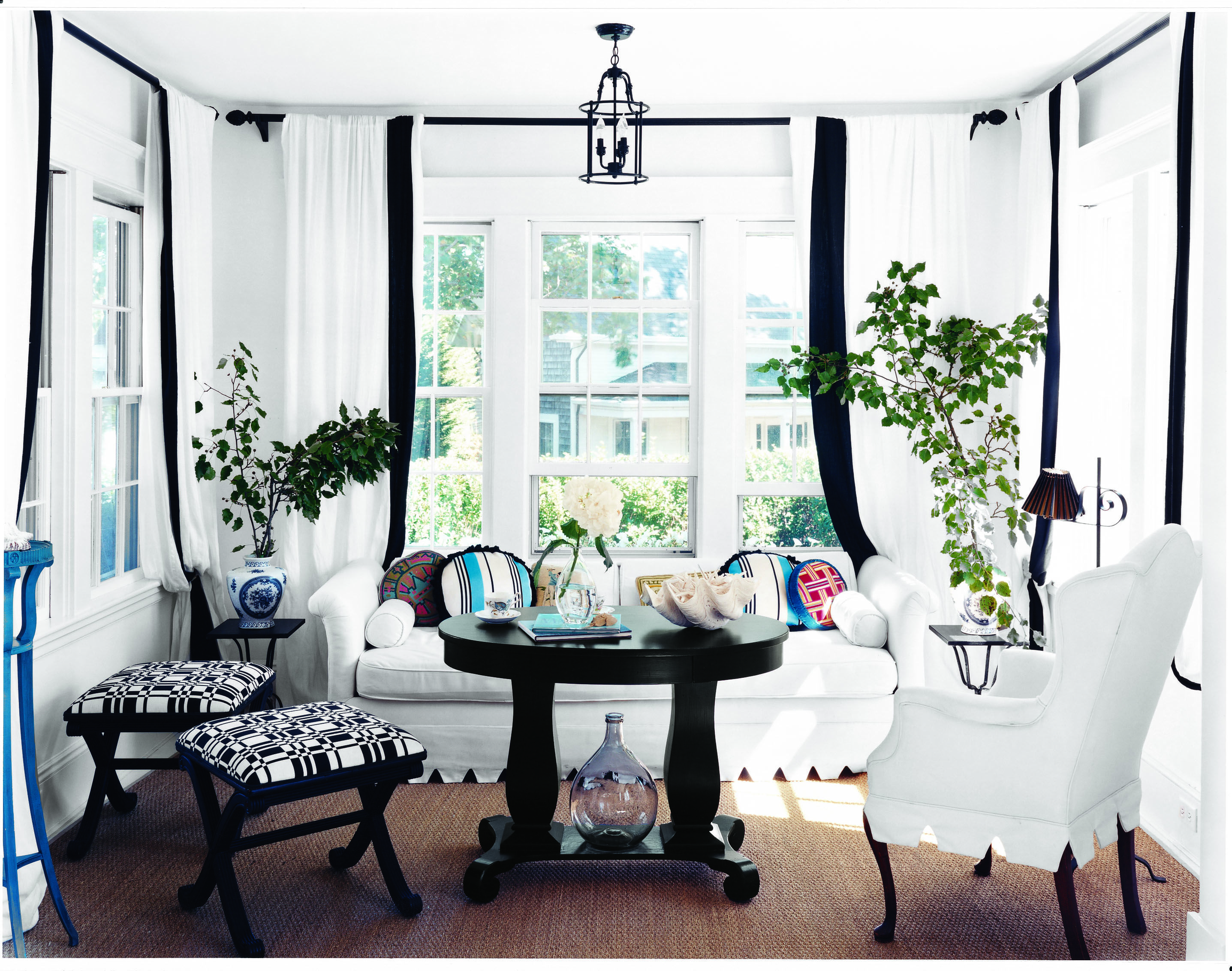 Thick black borders frame black and white furniture with a few pops ...