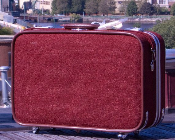 Red tweed rolling suitcase.