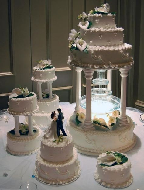 Four Tier Water Fountain Butter Cream Wedding Cake Decorated With