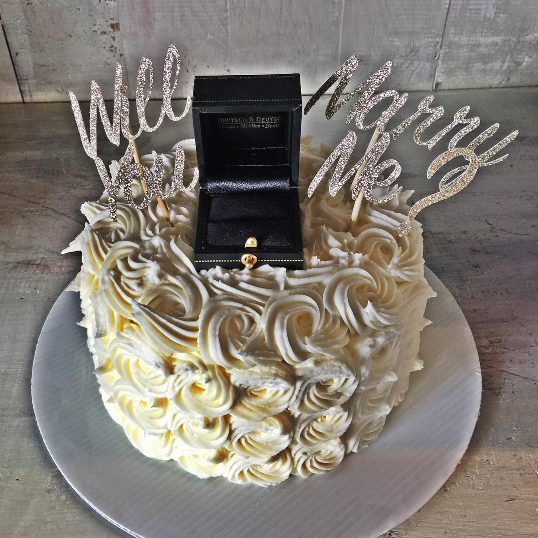 How gorgeous is this Proposal Cake?!?! #lovedit #proposal #gettingmarried #proposalcake #beautiful #caketopper #engagement