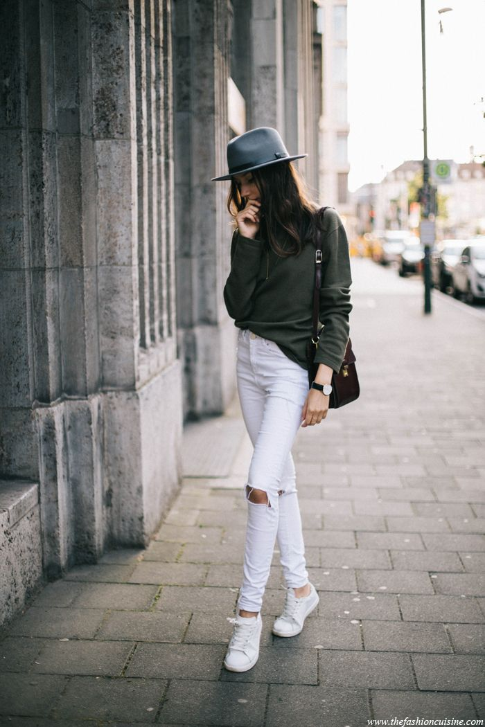 Wear a simple pair of white sneakers with your white white skinny jeans.  That will always work. Via Beatrice Gutu Sweater  DKNY, Jeans  Asos, Hat   Brixton, ... 8d44859941a