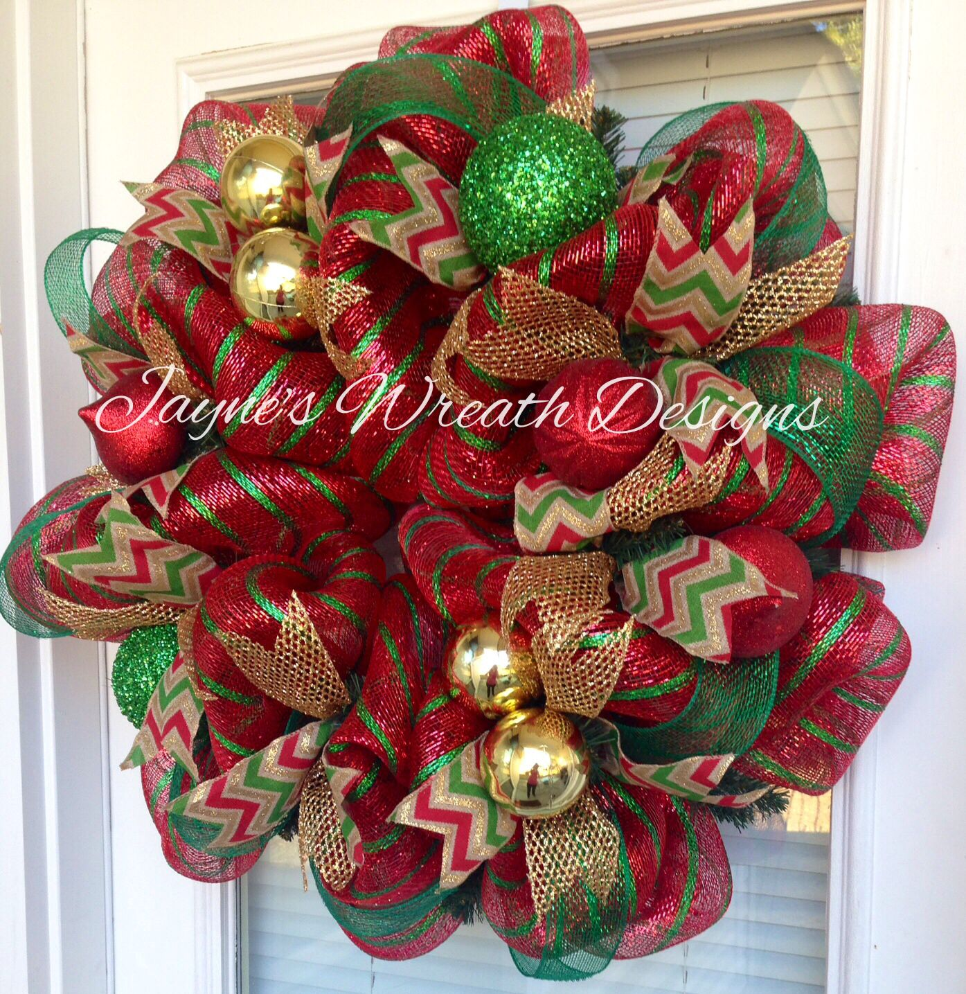 Deco mesh Christmas wreath in tradition green red and gold with