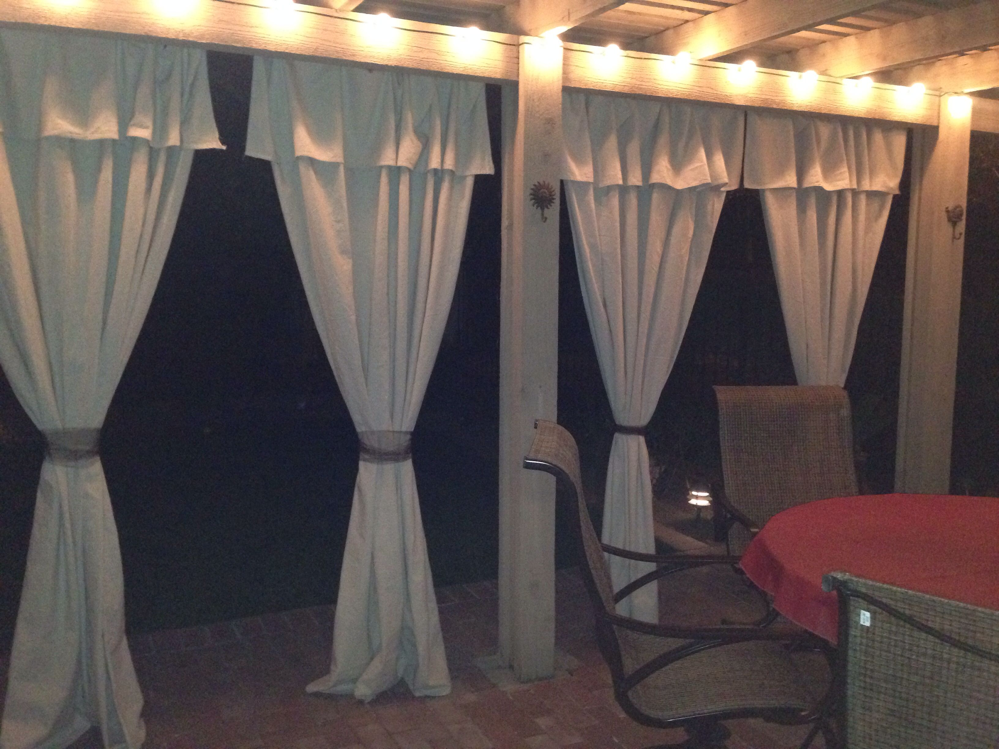 Love my new patio makeover with painters tarp curtains