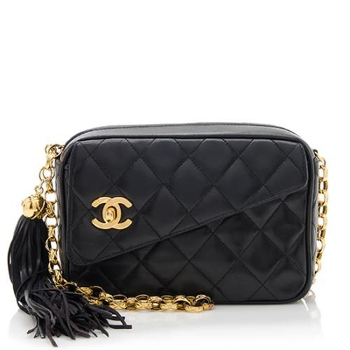 This classic Chanel camera bag is made from quilted black lambskin with  gold-tone hardware. Details include a chain-linked strap 1c0de5ee76dfd