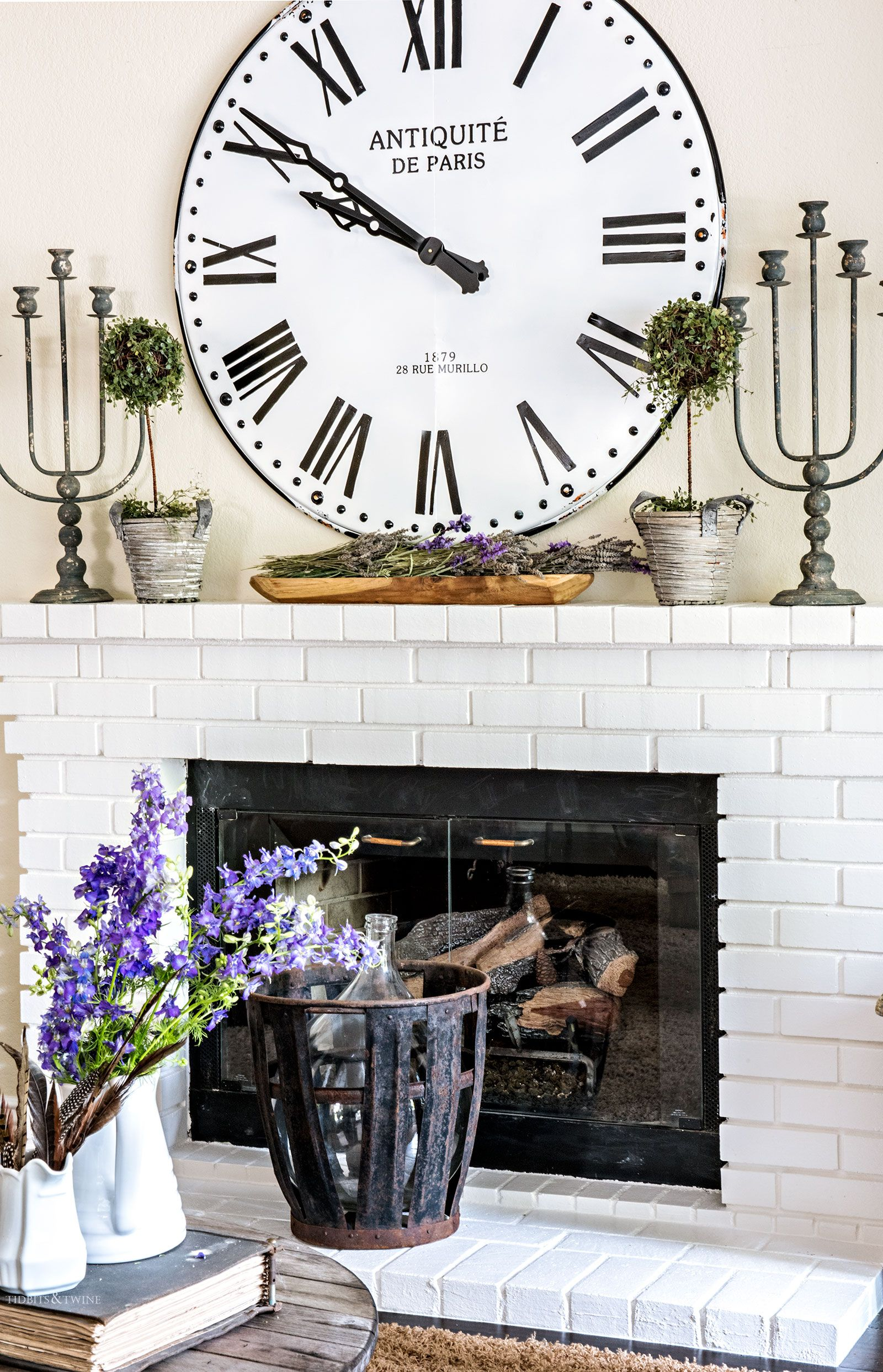 Decorating A Fireplace Mantel With An Oversized Clock And Topiaries For A French Farmhouse Look Fireplace Mantels Fireplace Decor Fireplace Mantel Decor