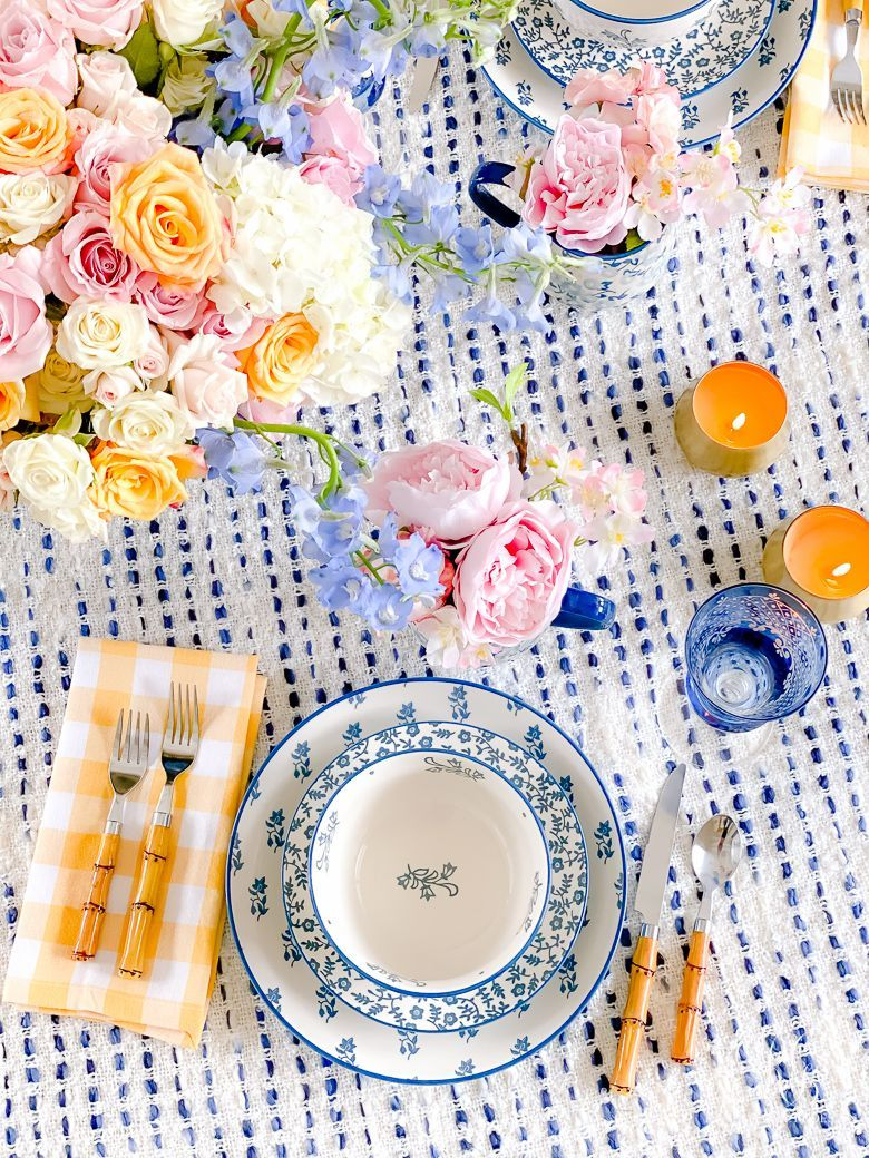 Home Decor Living Room spring table with pink yellow and blue #diningroom #tablescape #tablesetting #dining #diningroomdecor #formaldiningroom #kitchentable #diningtable #placesetting #plates #dinnertable #dinner #diningroomtable #bluedishes #floraldishes #bluefloral #bambooflatware #gingham #buffalocheck #roses #pinkroses #springfloralarrangement #springtablesetting #springdecor #springdecorations.Home Decor Living Room  spring table with pink yellow and blue #diningroom #tablescape #tablesetti