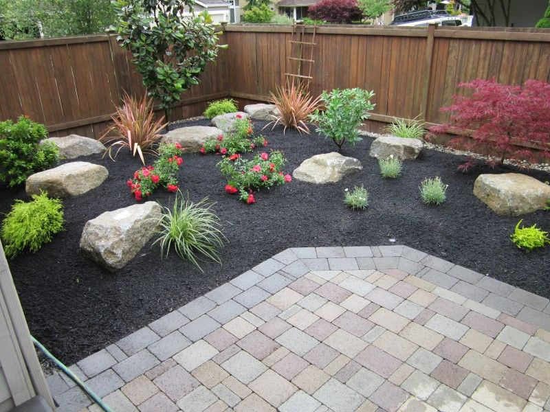 pavers for landscaping | large planter bed around a sand set paver