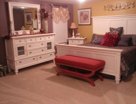 Bench, wall prints and decor accents completes and pulls bedroom together