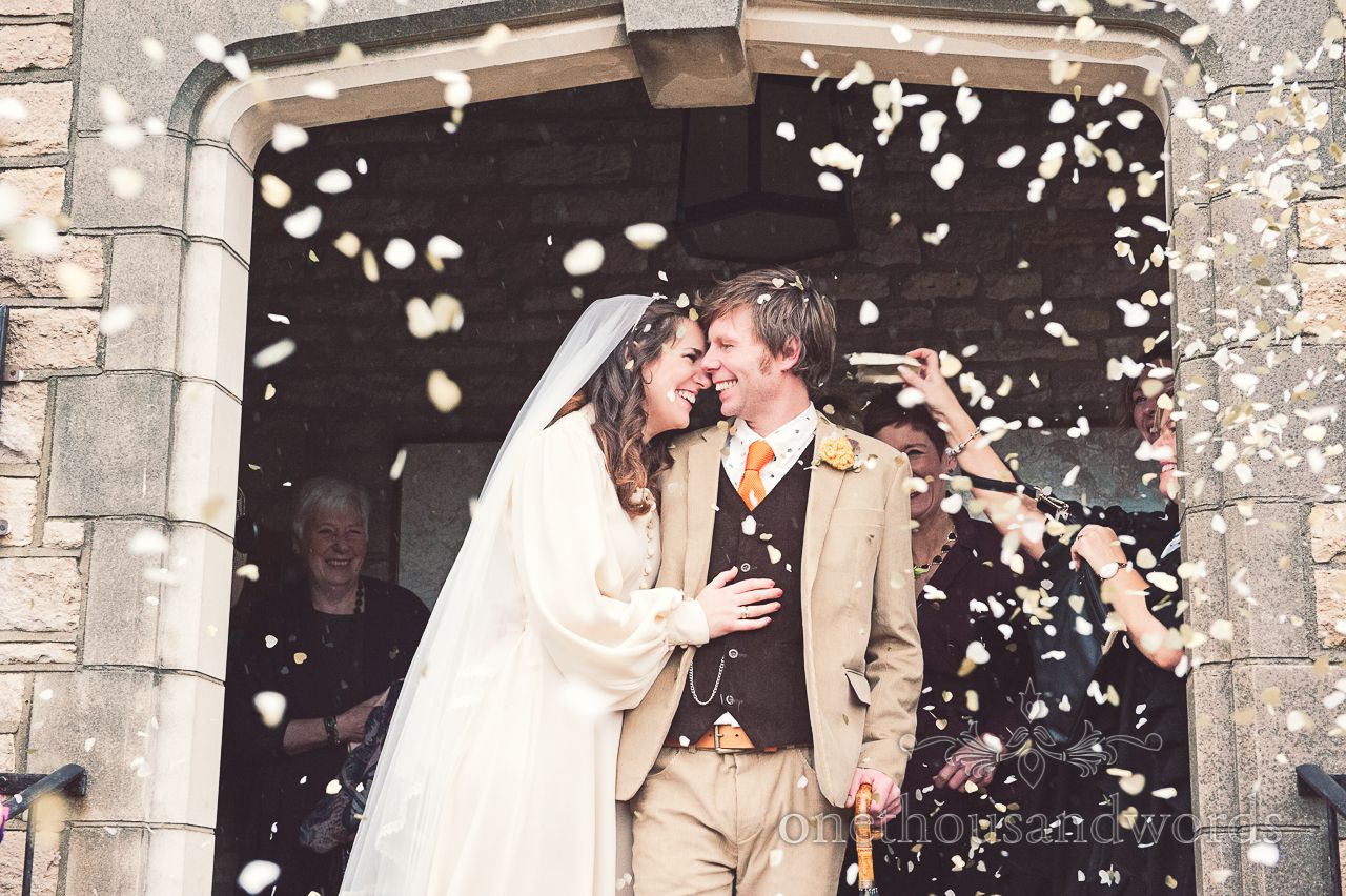 Wedding confetti at Mortons House Hotel wedding in Corfe, Dorset. Photography by one thousand words wedding photographers www.onethousandwords.co.uk