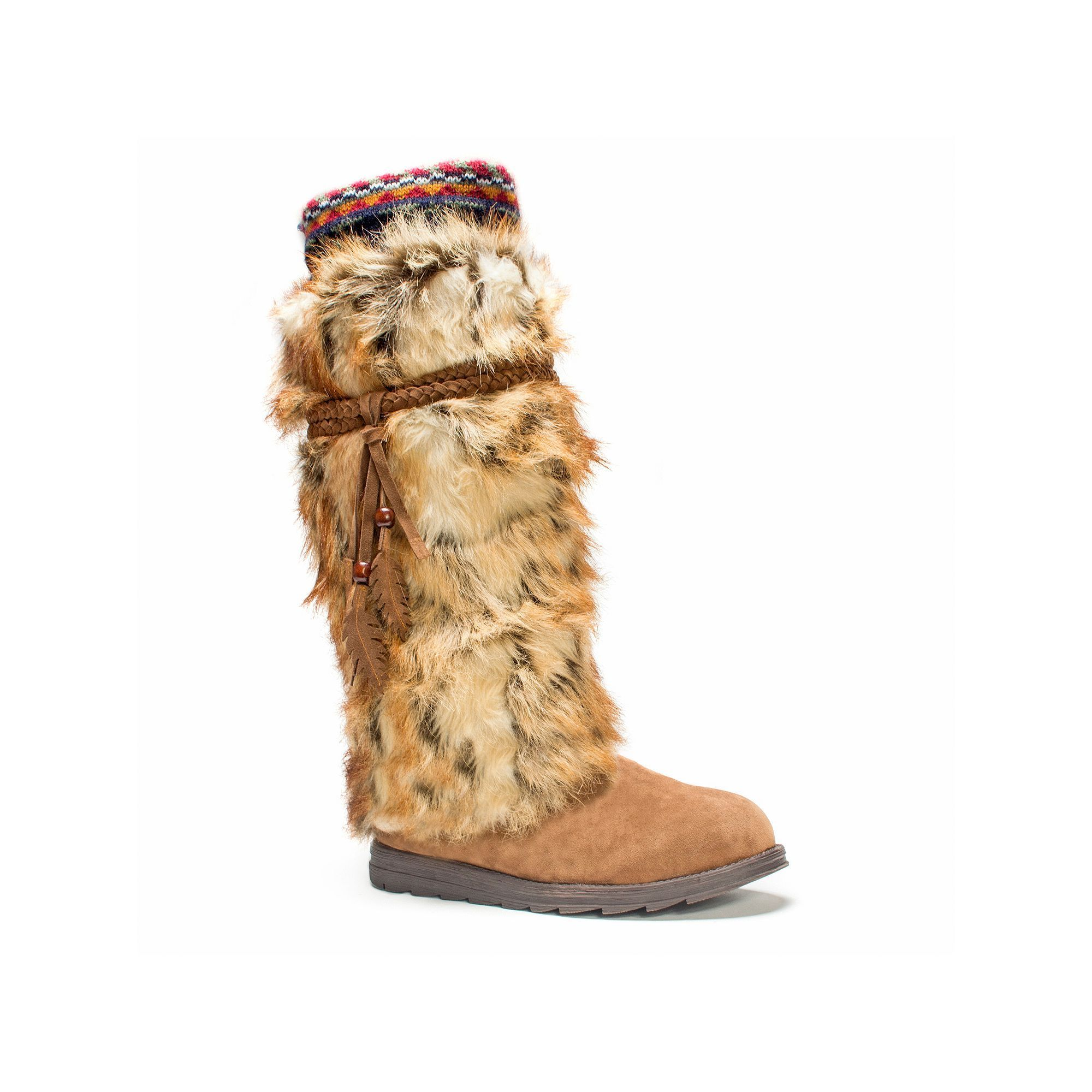Featuring a faux-fur shaft and feather accents, these women's MUK LUKS  winter boots stand out from the crowd. In dark brown.
