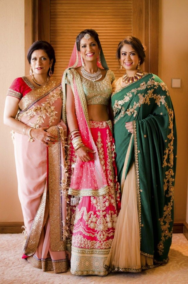 38dc40083f Wow, those are some well dressed relatives! Loving the pink and the green  saree, with golden embroidery. #indian #sari #wedding #guest