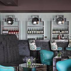 charcoal grey with aqua blue chairs / the Sherry Bar at Hispania London