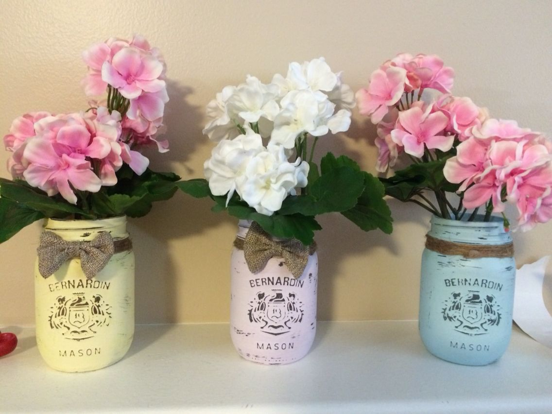 Project made with mason jars, chalk paint, twine & burlap and fake flowers.