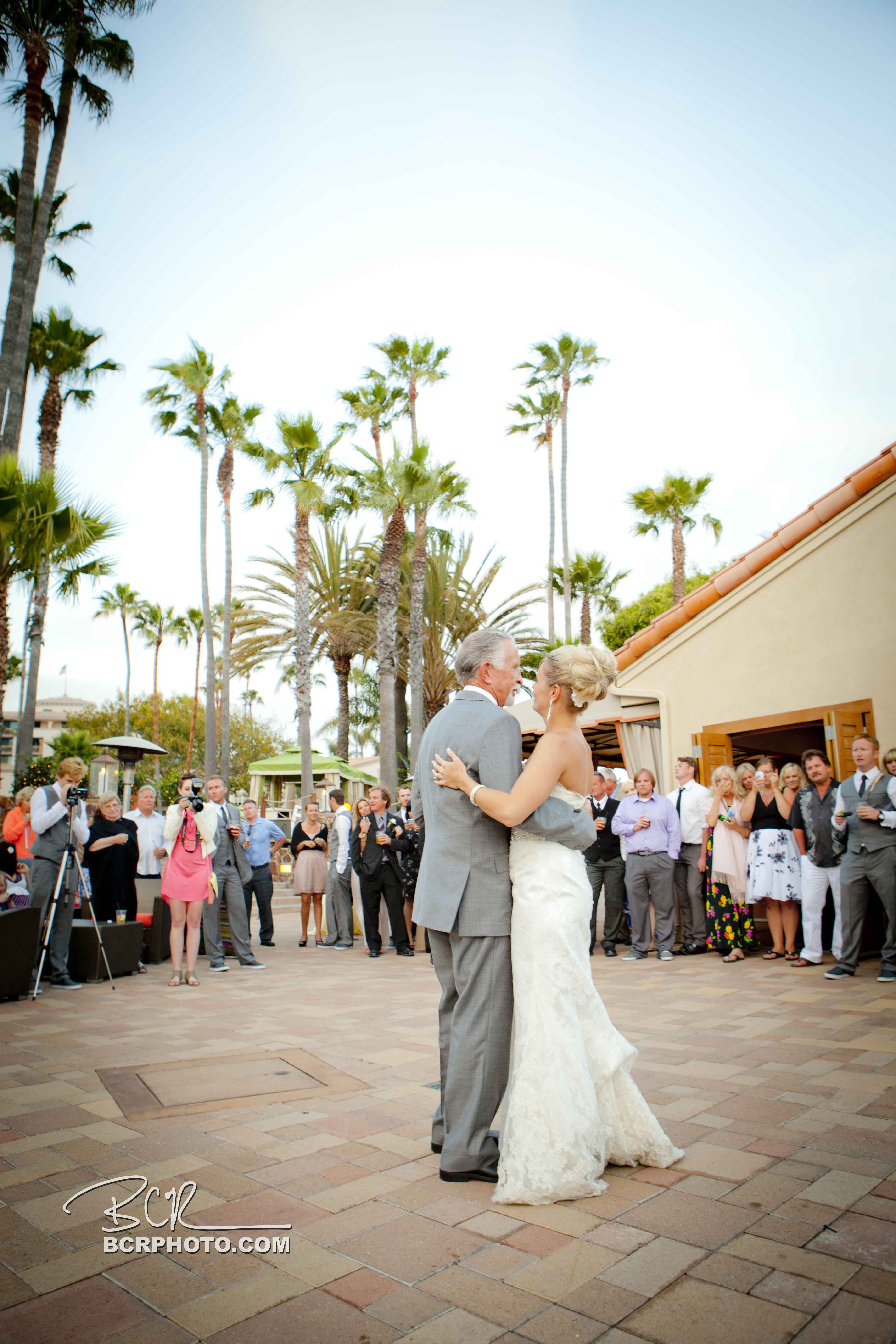 A special father-daughter dance under the palms captured beautifully by Brett Charles Rose Photography #sandiegoweddings