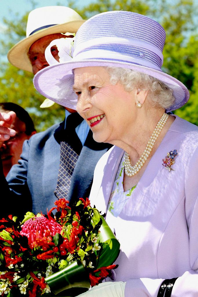"""On the 1st day of her last Australian tour in 2011, The Queen & Duke of Edinburgh visit """"Floriade"""" in Canberra. The Queen is wearing her pink & blue sapphire, ruby & diamond brooch, a gift from her parents when she was Princess Elizabeth."""