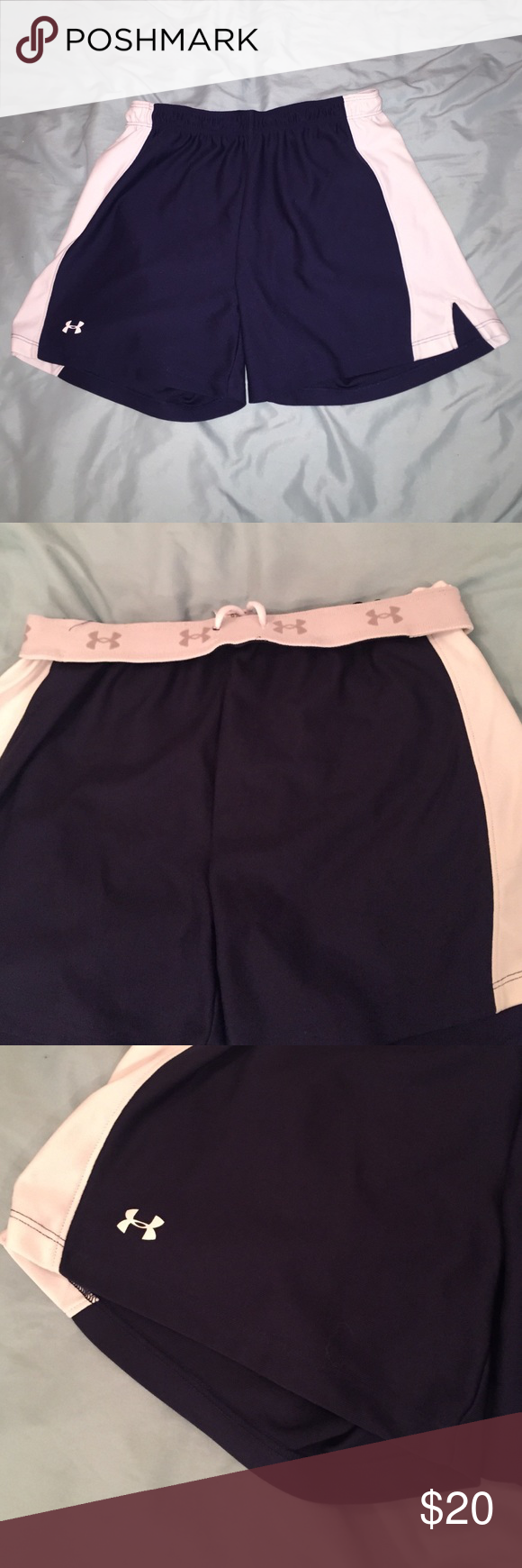 Under armour athletic shorts Navy blue with white stripes down the side. Waist band has the symbol all over it. Drawstring option to make the waist tighter. Tags are off but they were never worn, too small on me. Perfect condition Under Armour Shorts